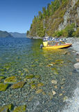 Tourist boats on the shore of Lake Teletskoe, Mountain Altai, Siberia, Russia Royalty Free Stock Photography