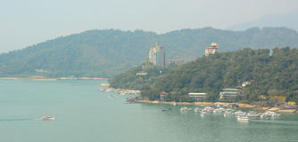 Tourist boats on Sun Moon Lake. Many tourist people take a trip by boats at the lake of famous attraction, Sun Moon Lake in Nantou county, Taiwan stock photography