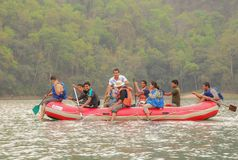 Tourist in the boats to Barahi Temple on Phewa lake, a popular tourist destination in Nepal stock photography