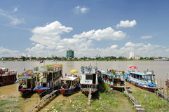 Tourist boats on tonle sap river in cambodia Royalty Free Stock Photos
