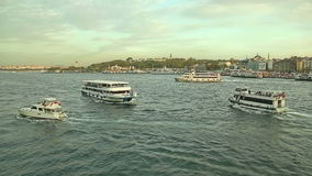Tourist boats traffic in Istanbul. ISTANBUL, TURKEY - SEPTEMBER 28, 2013 Tourist boats traffic outside the Istanbul harbor in sunset, a view from the Galata stock video