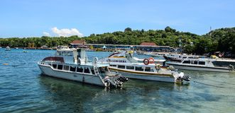 Tourist boats waiting at jetty in Lombok stock images