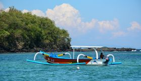 Tourist boats waiting at jetty in Lombok stock photography