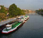 Tourist Boats waiting for Sightseeing Passengers on the Seine Ri Stock Image