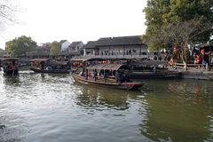 Tourist boats on the water canals of Xitang Town in China Stock Images