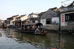 Tourist boats on the water canals of Xitang Town in China Stock Photo