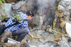 The tourist boiling eggs in hot sea park,tengchong,china Stock Photos