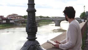 Tourist boy near Arno in Florence stock footage