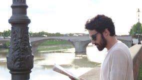 Tourist boy near Arno in Florence stock video