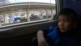 Tourist boy sitting on Japanese Bullet train in Tokyo