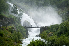 Tourist on the bridge and waterfall splashes Royalty Free Stock Photos