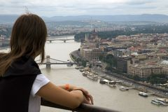 Tourist in budapest. Looking over danube river and parliament building Royalty Free Stock Photography
