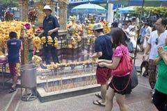 Tourist buddhist paying respect on Ratchaprasong Erawan shrine Royalty Free Stock Images