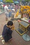 Tourist buddhist paying respect on Ratchaprasong Erawan shrine Royalty Free Stock Photo