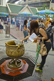 Tourist buddhist paying respect on Ratchaprasong Erawan shrine Royalty Free Stock Image
