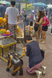 Tourist buddhist paying respect on Ratchaprasong Erawan shrine Stock Photography