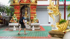 Tourist in Buddhist temple of Chiang Mai Thailand