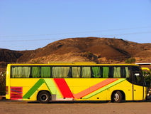 Tourist Bus. A tourism bus in a mountainous countryside in India Stock Photo