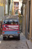 Tourist bus by an alley Royalty Free Stock Photography