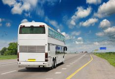 Tourist bus on the asphalt road. royalty free stock photography