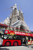 Tourist Bus in Barcelona. Barcelona, Spain - May 26, 2015: People exit a tourist coach in front of the Sagrada Familia Gaudi cathedral, on May 26, 2015 in Stock Image