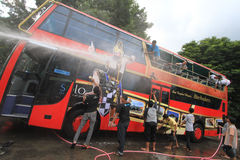 Tourist Bus Care Werkudara. Some members of the community of lovers bus wash buses Werkudara in Solo, Central Java, Indonesia. Bus Werkudara is access to Royalty Free Stock Images