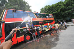 Tourist Bus Care Werkudara. Some members of the community of lovers bus wash buses Werkudara in Solo, Central Java, Indonesia. Bus Werkudara is access to Stock Image
