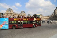 Tourist bus drives past the Louvre in Paris, France Royalty Free Stock Images