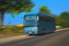 Tourist bus goes on the highway Stock Photos