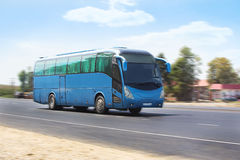 Tourist bus goes on the highway Royalty Free Stock Photo