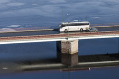 The tourist bus going on  bridge through  river Royalty Free Stock Photography