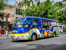 Tourist bus on Kalakaua avenue Stock Photography