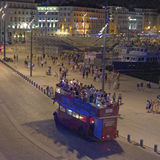 Tourist bus in Marseilles. Tourists in the harbor and on a tourist bus in Marseilles, France Stock Photos