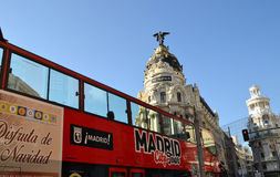Tourist bus near Metropolis Building in Gran Via, Madrid, Spain Royalty Free Stock Photos
