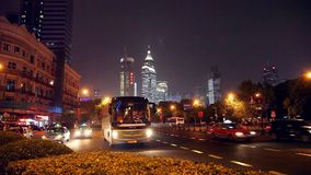 Tourist bus in night traffic on the street of Shanghai, China stock video footage