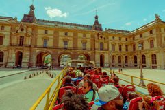 Tourist bus passing the Louvre Museum exterior Royalty Free Stock Photography