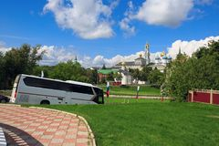 Tourist bus on the road in front of the Trinity Lavra of St.Sergius. Sergiyev Posad, Russia Stock Photography