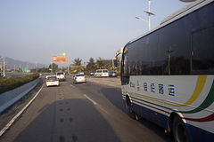 Tourist bus on the road Hainan island Stock Photography