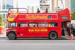 Tourist bus stopped next to Dundas Square Royalty Free Stock Photos