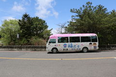 Tourist Bus Taiwan - April 12, 2015. Taiwan - April 12: Tourist Bus Parks Along the Road on April 12, 2015. This Bus leaves from Sun Moon Lake heading to Alishan Stock Photo