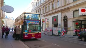 Tourist bus on terminal station, Vienna, Austria. Vienna, Austria - February 17, 2019: The hop-on hop-off double-decker waits the tourists on its terminal stock footage