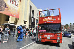 Tourist bus tour. A shot of a bus tour in Hollywood California Royalty Free Stock Images