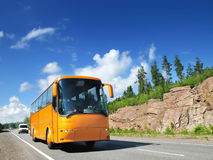 Tourist bus and traffic on country highway. Tourist bus and cars on rural highway Royalty Free Stock Photos