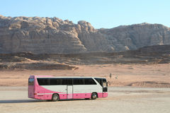 Tourist bus in Wadi Rum. Beautiful Buses to transport tourists In different parts of Jordan, These buses mostly belonging to tourism companies, And equipped with royalty free stock image