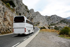 Tourist bus on winding road Royalty Free Stock Photo