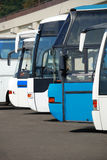 Tourist buses on a parking. Expect passengers Stock Photos