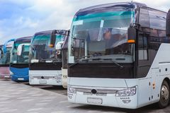 Tourist buses on parking. On the background of cloudy sky royalty free stock photos