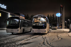 Tourist buses in a parking lot in the winter. Imatra, Finland Royalty Free Stock Image
