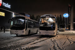 Tourist buses in a parking lot in the winter. Imatra, Finland Stock Images