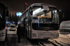 Tourist buses in a parking lot in the winter. Imatra, Finland Stock Image